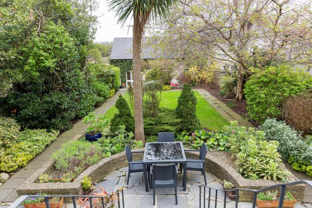 The landscaped garden has its original granite walls and the original coach house has permission for conversion