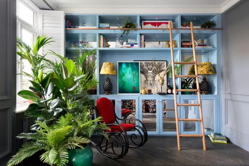 The living room of Lafferty's design features concealed and open shelving