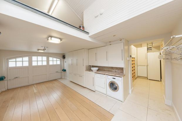 The garage has been converted into a huge utility room