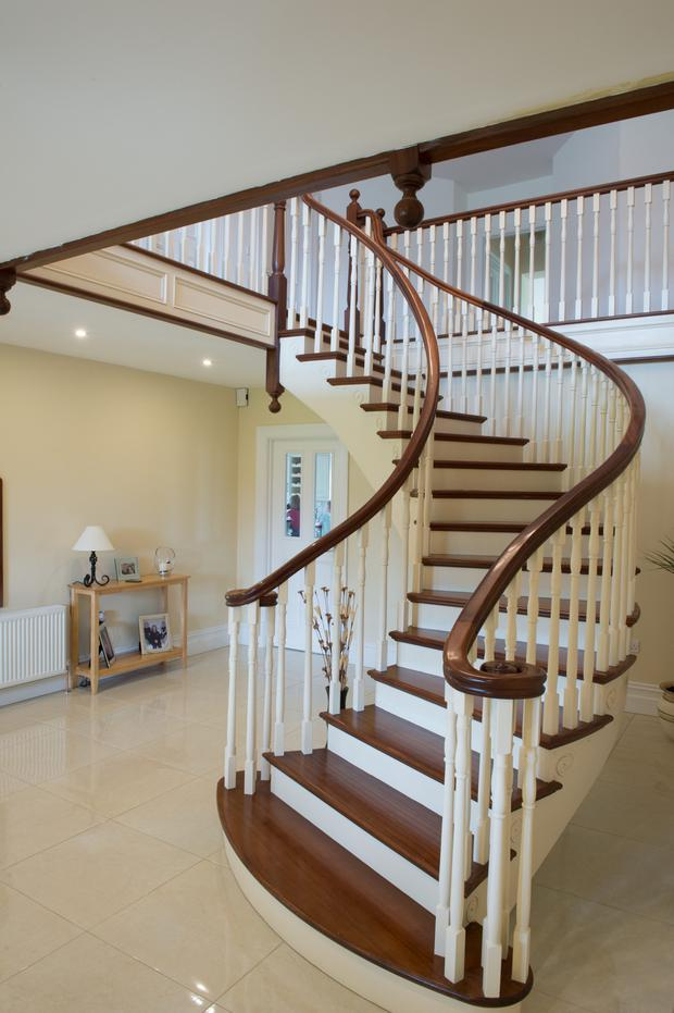 The lavishly fitted-out interior includes a curved oak staircase