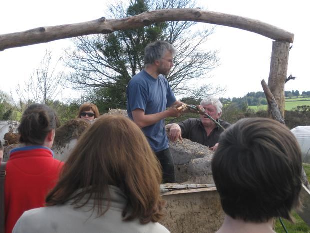 Thomas Riedmuller leads courses in cob-building techniques;