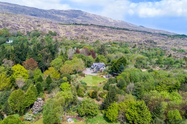 An aerial view of the house and lavish grounds