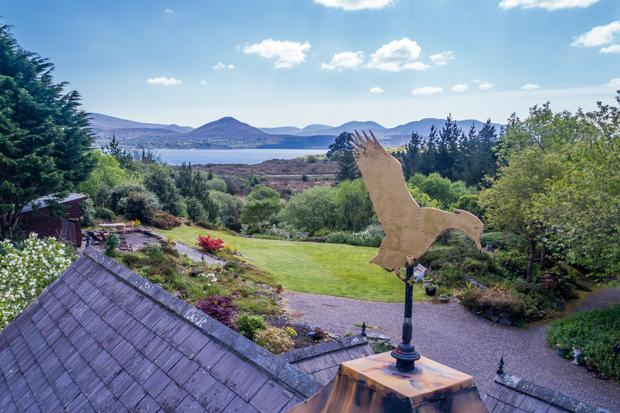 A weather vane with mountains in the background