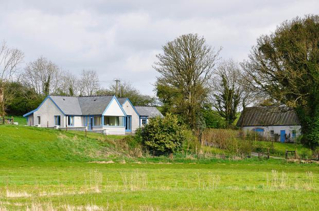The four-bedroom cottage is on 17 acres and includes a two-storey shed on the grounds