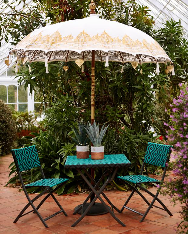 Carolyn Donnelly's Eclectic bistro range with woven faux rattan on the table and chairs and Bali parasol;
