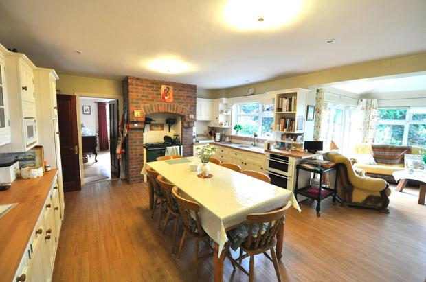 The large kitchen features a Stanley range cooker