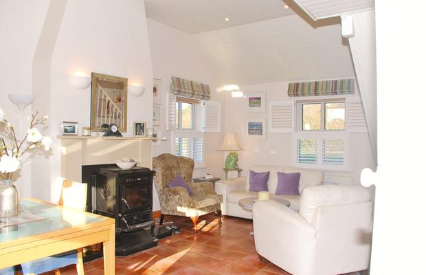 The open-plan downstairs living area with a solid-fuel stove