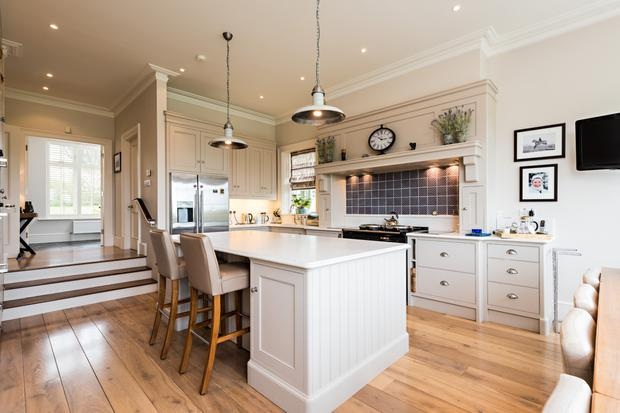 The fitted kitchen has an island unit with extra storage