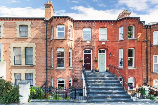 19 Hollybank Road - a three-storey terraced red-brick house