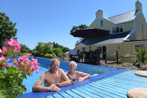 Ann and Martin Butcher in the outdoor pool at Forest Lodge, Co Wexford. Photo: Bryan Meade