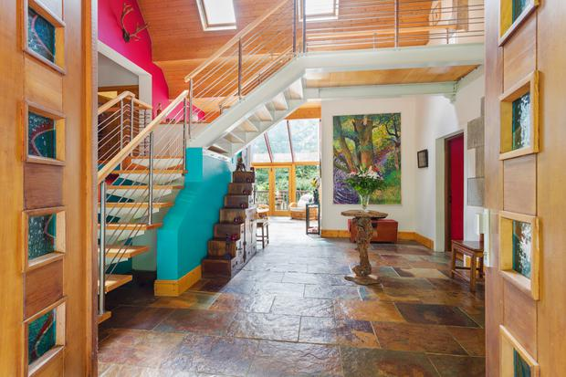 The hallway runs from the front of the house towards a sunroom at the back