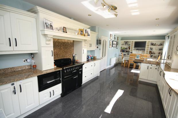 The fitted kitchen with granite countertops