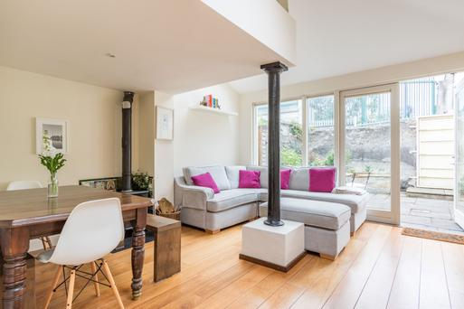 No 17 Prospect Square has a spacious open-plan living/dining area in a modern extension that has retained the rough rendered brick, granite lintel and cast iron column of the original house