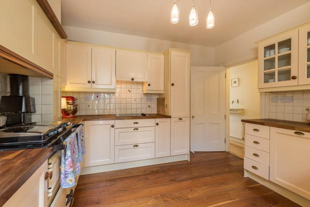 The kitchen is fitted with a Rayburn cooker that heats the radiators