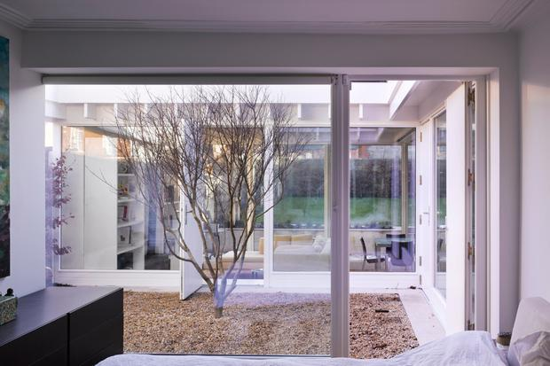Lynda 'wakes to happiness every single day' as her bedroom looks onto the courtyard
