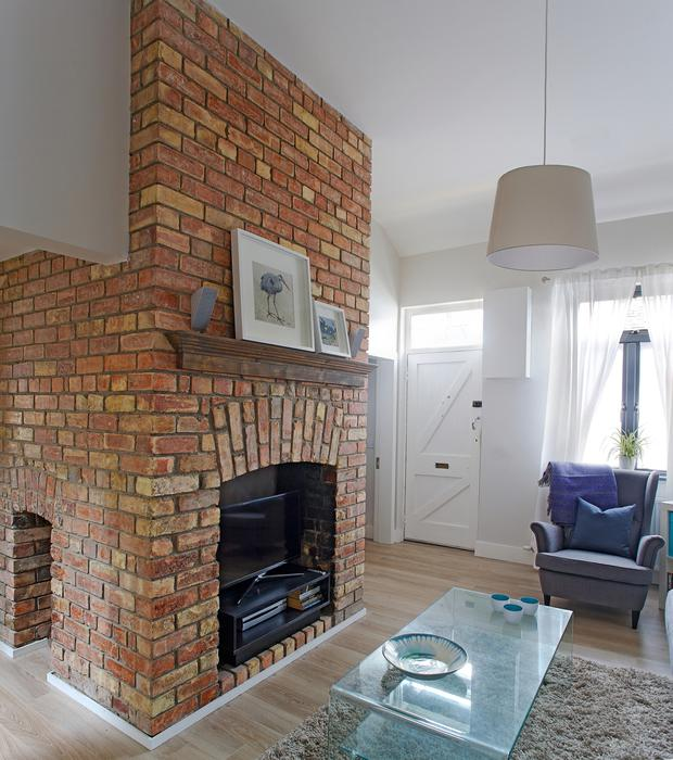 Detail of the red-brick fireplace