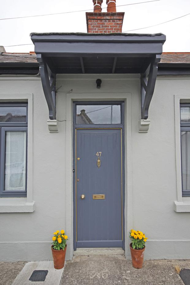The exterior is painted in contrasting shades of grey