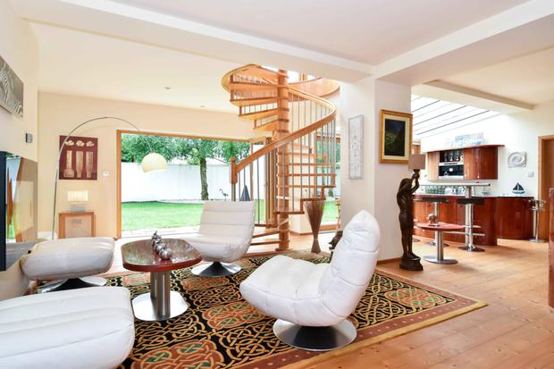 The family/entertainment room opens to the garden