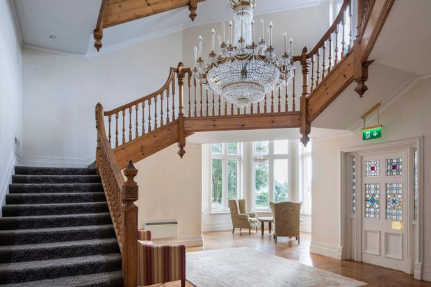 The imposing entrance hall with ornate staircase