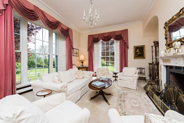 Dual-aspect drawing room with cornicing detail and high ceilings that are throughout the property