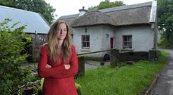 Mikal O'Boyle outside the family cottage in Lecarrow, Knock, Co Mayo. Photo: Bryan Meade