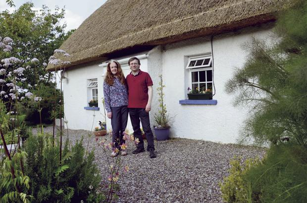 Emma Byrne and her husband Jonathan Rossney beside their Co Wexford cottage. Photo: Bryan Meade
