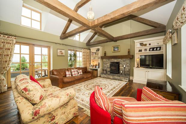 The family room with vaulted ceiling and brick-surround fireplace
