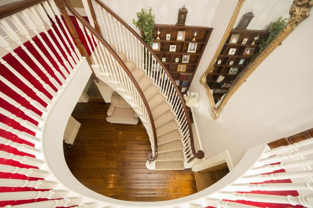 Looking down on the dramatic curved staircase