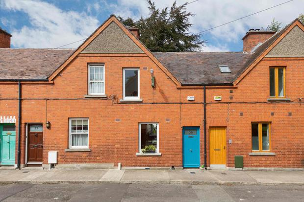 The property is a smart redbrick terrace