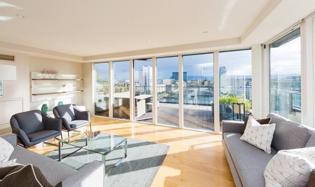 The upstairs living room, which opens out to a rooftop terrace