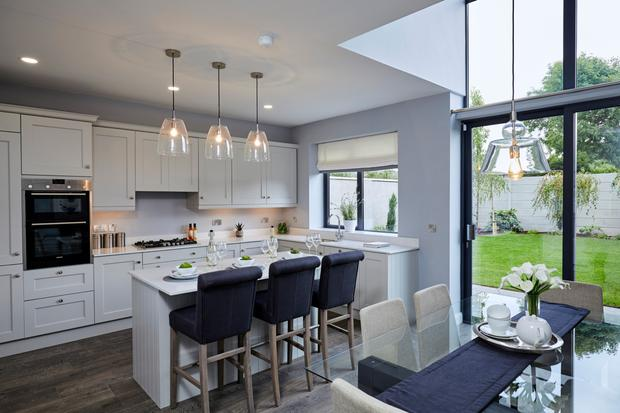 The open-plan kitchen and dining room at the Castle Vernon development features quartz worktops and a breakfast bar in the island unit