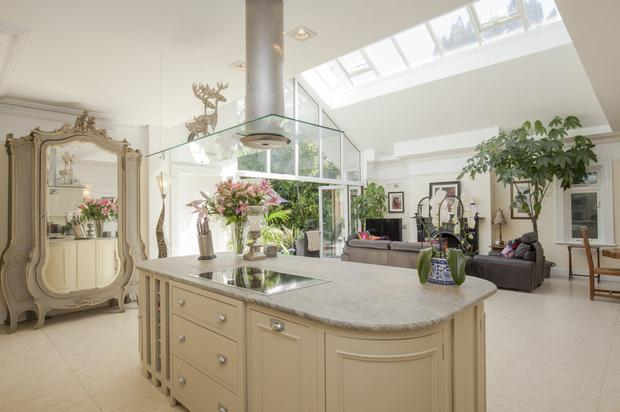 The kitchen end of the open-plan extension with folding doors to the sun terrace