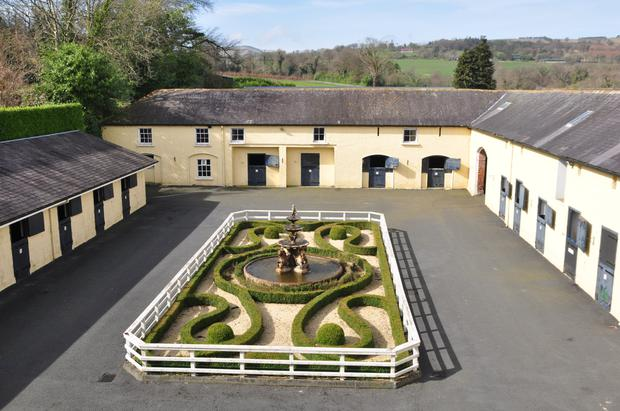 The original courtyard with its ornate box and fountain features