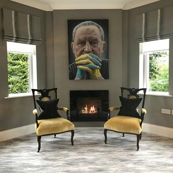 The Kyle Barnes painting on the wall was the inspiration for the colour palette, the carpet is Mineral Sea Glass from Ulster Carpets and the antique chairs were upholstered with velvet from GP & J Baker