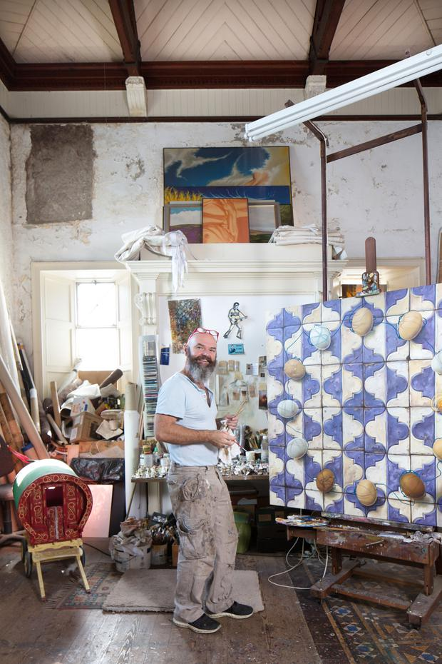 Artist Laurence O'Toole at work in his studio at Old Bank House, Muine Beag Photo: Tony Gavin
