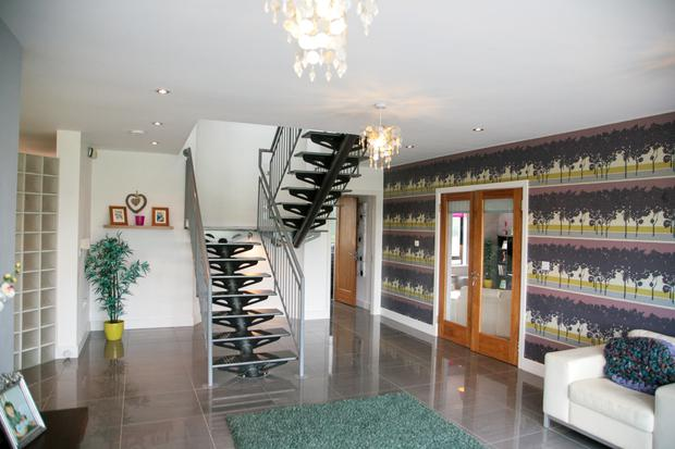 The entrance hall with feature staircase
