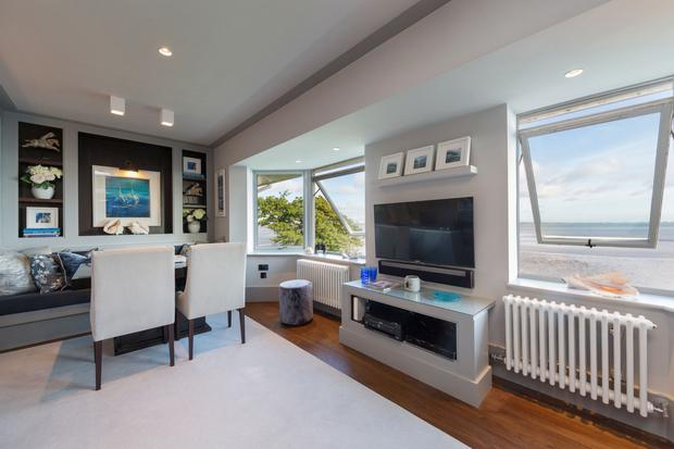 The open-plan living, dining room and kitchen overlooks the water