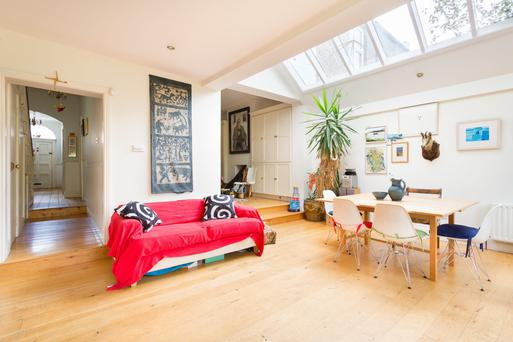 The open-plan kitchen and dining room with an apex roof light