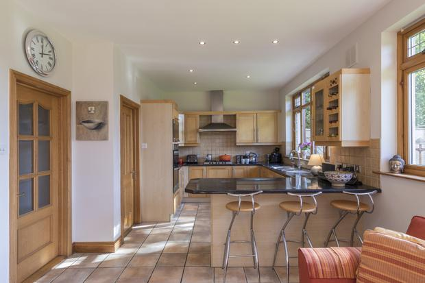 The kitchen is open-plan to a dining and living space