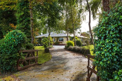 The 2,026 sq ft bungalow stands on an acre, with eight more acres available