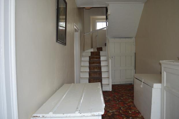 The stairway in the Roscommon property