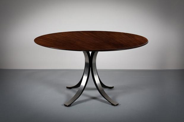 An Italian dining table on a metal base
