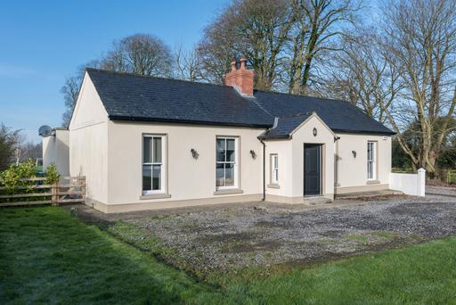 Behind the dainty cottage is a large extension