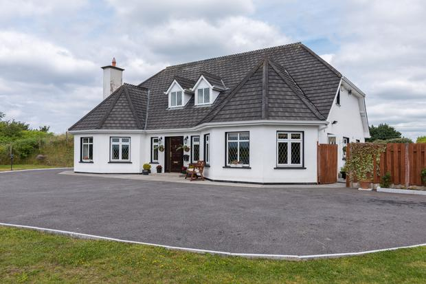 The house is 3,305 sq ft in a dormer arrangement