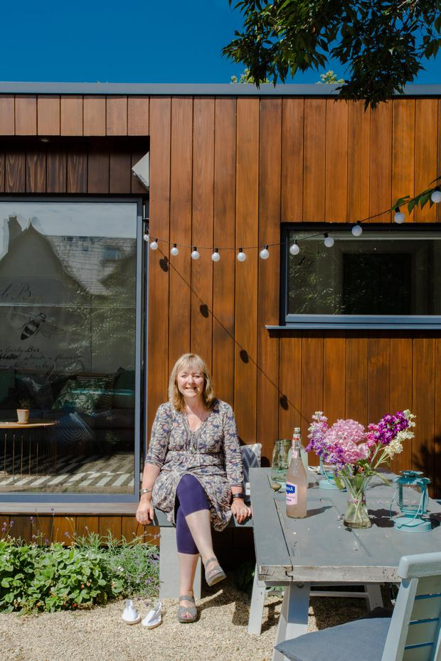 Niamh O'Carroll and her garden room in Dublin which is used as an office during the day and a multi-purpose family space at weekends Photo: Bryan Meade