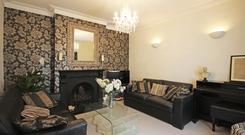 The living room with feature wallpaper