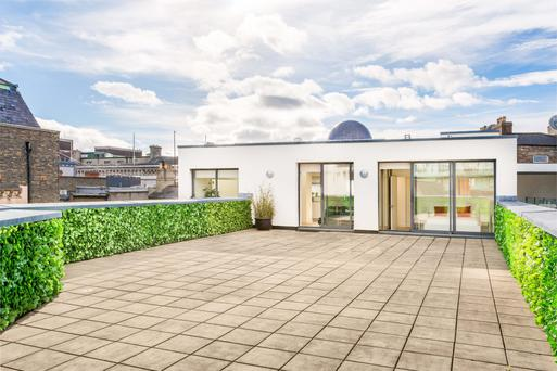 Number 20 has a roof terrace accessed from the sitting/dining room