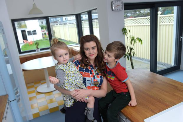 The Beaumont mid-terrace is home to Barbara Downey (left), Micheal Cannon and their children, Bran and Luan