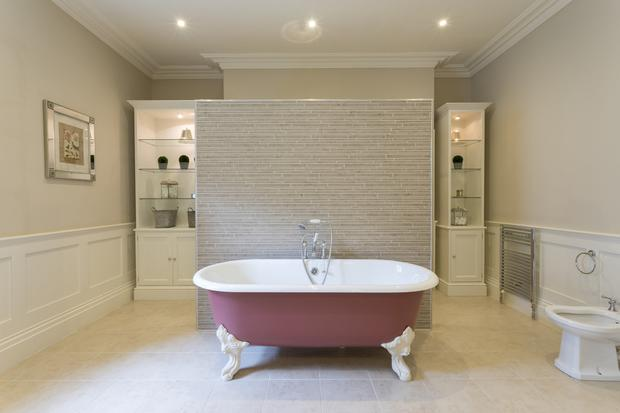 The luxury stand alone tub at one of Malakoff's four bathrooms