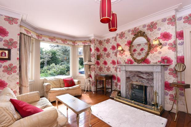 The lounge with effervescent pink floral wallpaper